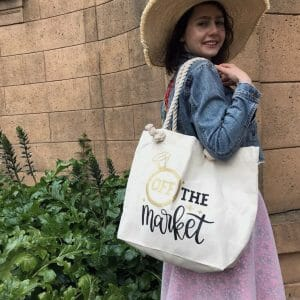 Young woman wearing an off the market tote bag