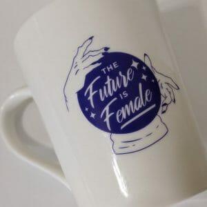 the future is female white 14oz mug front